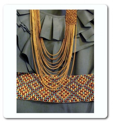 Photo of top, necklace and belt